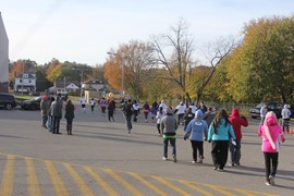 5K participants running near the starting line