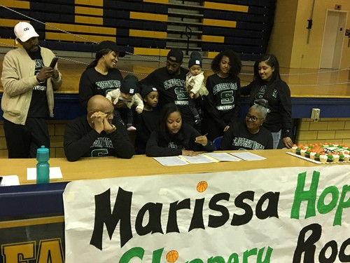 Marissa Hopson signing her National Letter of Intent to attend Slippery Rock on a full basketball scholarship