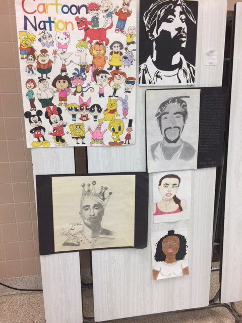 Various student art pieces on display at the art show
