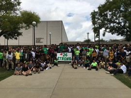 Farrell School District students and staff wore green and donated to support an injured Laurel High School student athlete