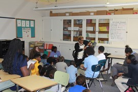Superintendent Dr. Lora Adams-King reads to 6th grade students during the African American Read-In