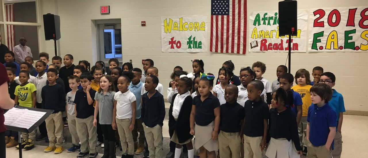 First grade students singing to kick off the National African American Read-In