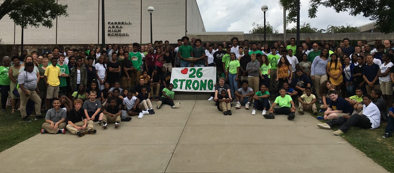Farrell High School dresses in green and shows their support for an injured Laurel High School athlete