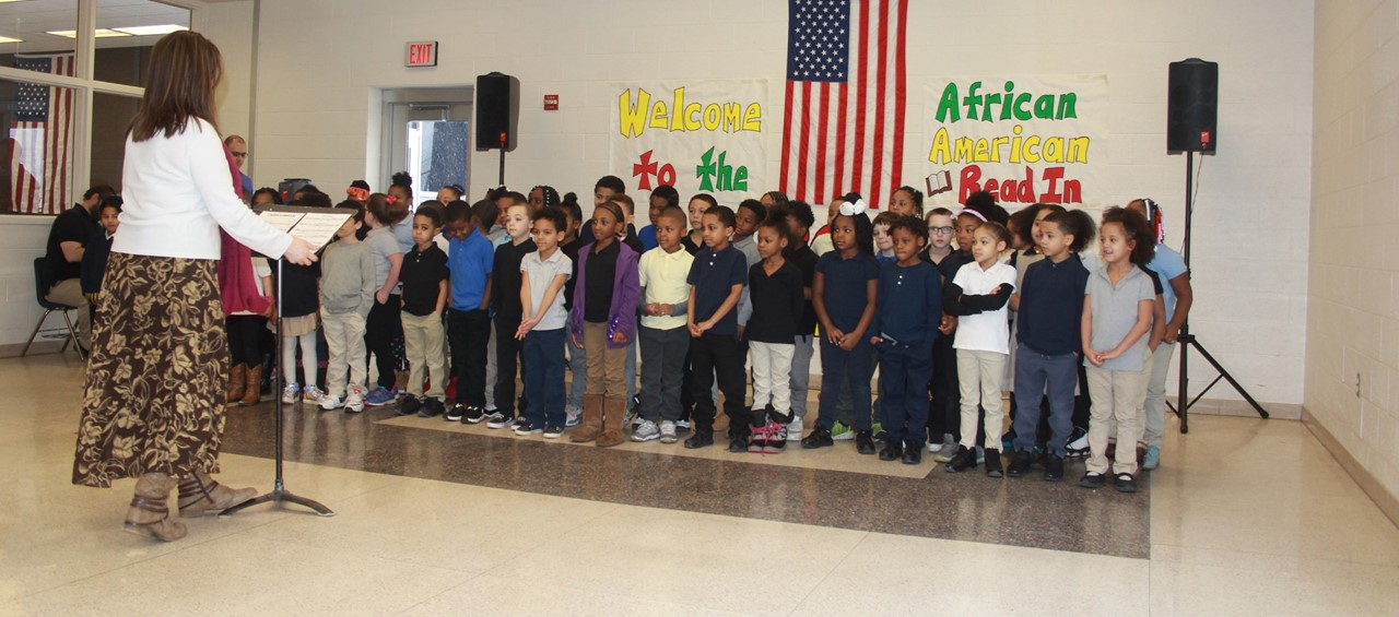 1st grade students sing to guests at the African American Read In