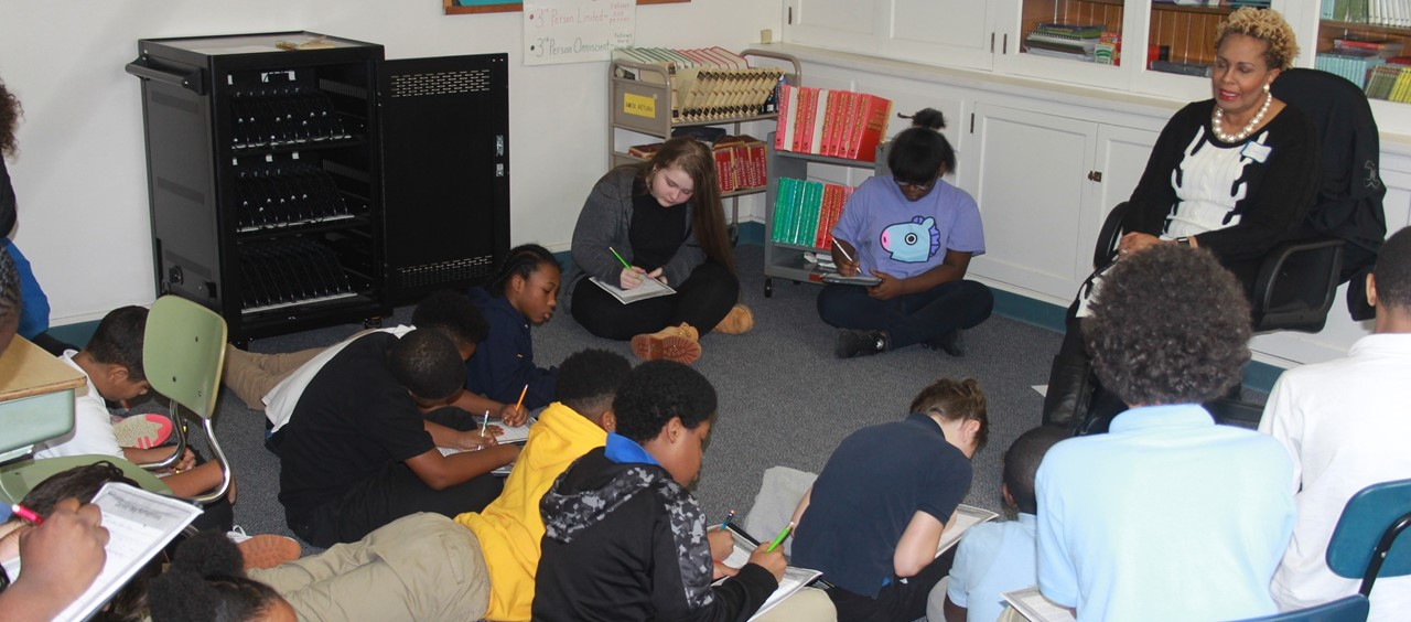Superintendent Dr. Lora Adams-King talking to students during the African American Read In